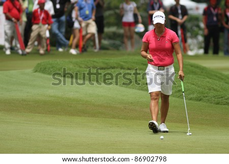 KUALA LUMPUR, MALAYSIA - OCTOBER 16: Yani Tseng of Chinese Taipei prepares to putt at the green of hole #18 at the Sime Darby LPGA 2011 golf tournament on Oct 16, 2011 in Kuala Lumpur, Malaysia. - stock photo