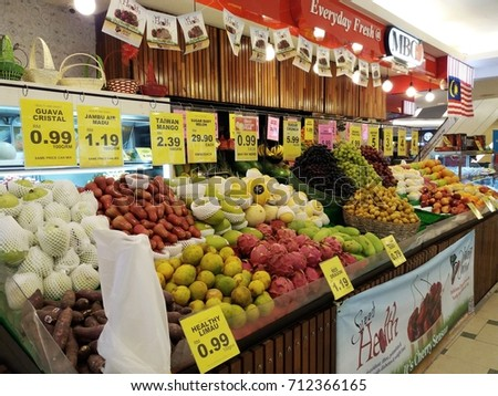 Kuala Lumpur , Malaysia - 9 September 2017 : Display a fresh fruits and vegetables on the line or row at stall market/selective focus.