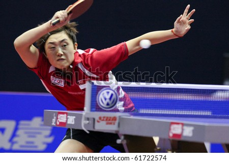 KUALA LUMPUR, MALAYSIA - SEPTEMBER 24: Feng Tianwei, Singapore (ITTF World Rank 2) returns with a smash at the Volkswagen 2010 Women's World Cup in table tennis on September 24, 2010 in Kuala Lumpur. - stock photo