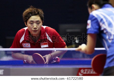 KUALA LUMPUR, MALAYSIA - SEPTEMBER 24: Feng Tianwei, Singapore (ITTF World Rank 2) waits to return serve at the Volkswagen 2010 Women's World Cup in table tennis on September 24, 2010 in Kuala Lumpur. - stock photo