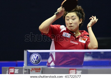KUALA LUMPUR, MALAYSIA - SEPTEMBER 24: Feng Tianwei, Singapore (ITTF World Ranking #2) hits a return at the Volkswagen 2010 Women's World Cup in table tennis on September 24, 2010 in Kuala Lumpur. - stock photo