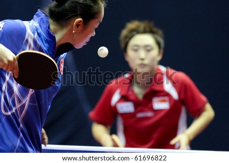 KUALA LUMPUR, MALAYSIA - SEPTEMBER 24: Tie Yana, Hong Kong serves the ball to Feng Tianwei of Singapore at the Volkswagen 2010 Women's World Cup in table tennis on September 24, 2010 in Kuala Lumpur. - stock photo