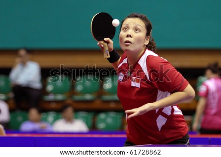 KUALA LUMPUR, MALAYSIA - SEPTEMBER 24: Wang Yuegu, Singapore (ITTF World Rank 21) tosses ball to serve at the Volkswagen 2010 Women's World Cup in table tennis on September 24, 2010 in Kuala Lumpur. - stock photo