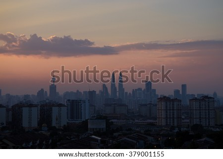 KUALA LUMPUR, MALAYSIA - 17TH FEBRUARY 2016; Sunset in Kuala Lumpur, the capital of Malaysia. Its modern skyline is dominated by the 451m-tall KLCC, a pair of glass-and-steel-clad skyscrapers.