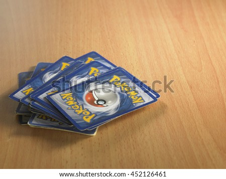 Kuala Lumpur,Malaysia 13th July 2016 , pokemon card game on the wooden table - stock photo