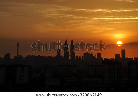 KUALA LUMPUR, MALAYSIA - 30TH JUNE 2013; View of The Petronas Twin Towers during sunset on June 30, 2013 in Kuala Lumpur, Malaysia. Petronas are the tallest twin buildings in the world (451.9 m).
