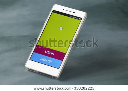 kuala lumpur-malaysia, 16th november 2015,smart phone display with snap chat log in page - stock photo