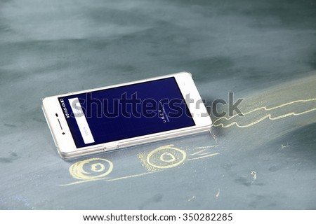 kuala lumpur-malaysia, 16th november 2015,smart phone display with uber app log in page - stock photo