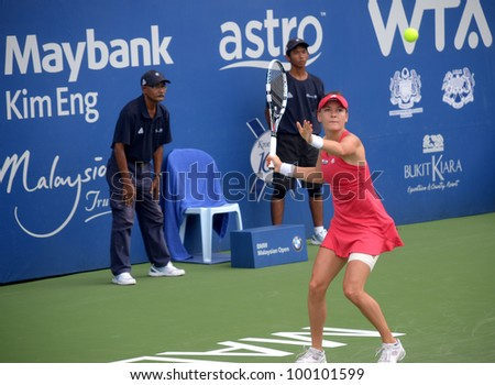 KUALA LUMPUR - MARCH 1: Agnieszka Radwanska (POL) returns the ball while compete against Karolina Pliskova (Czech) during BMW Malaysia Open on March 1, 2012 in Kuala Lumpur. Radwanska won (6:4,6:4)