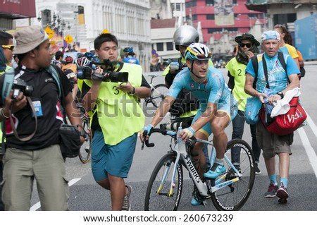 KUALA LUMPUR - MARCH 15 : Andrea Guardini(ITA) rider from Astana Pro Team surrounded by reporters after winning stage 8 Le Tour de Langkawi 2015 at Kuala Lumpur, Malaysia on March 15, 2015. - stock photo