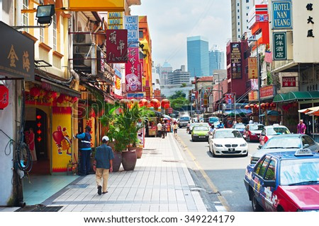 KUALA LUMPUR - MARCH 20, 2012: Chinatown street in Kuala Lumpur. KL is the capital and most populous city in Malaysia. Covers an area of 243 km2 and has population of 1.6 million in 2012 - stock photo