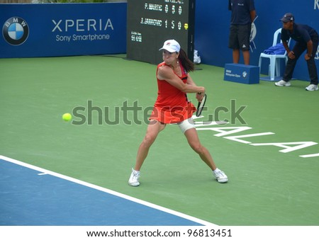 KUALA LUMPUR - MARCH 4: Jelena Jankovic returns ball during a semi-finals match against Petra Martic at the BMW Malaysian Open on March 4,2012 in Kuala Lumpur, Malaysia.Petra Martic win [6-7(5-7),7-5,7-6 (7-5)] - stock photo