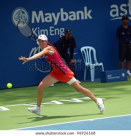 KUALA LUMPUR -MARCH 4: Jelena Jankovic returns ball during a semi-finals match against Petra Martic at the BMW Malaysian Open on March 4,2012 in Kuala Lumpur.Petra Martic win [6-7(5-7),7-5,7-6 (7-5)] - stock photo