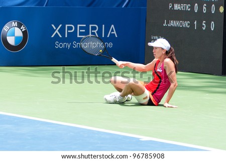 KUALA LUMPUR-MARCH 4: Jelena Jankovic (SRB) fell during her match against Petra Martic (CRO) at the BMW Malaysia Open on March 4, 2012 in Kuala Lumpur, Malaysia. Jankovic lost 6:7 (5), 7:5, 7:6 (5) - stock photo