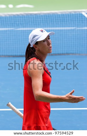 KUALA LUMPUR-MARCH 4: Jelena Jankovic (SRB) reacts during her match against Petra Martic (CRO) at the BMW Malaysian Open on March 4, 2012 in Kuala Lumpur, Malaysia. Jankovic lost 6:7 (5), 7:5, 7:6 (5) - stock photo