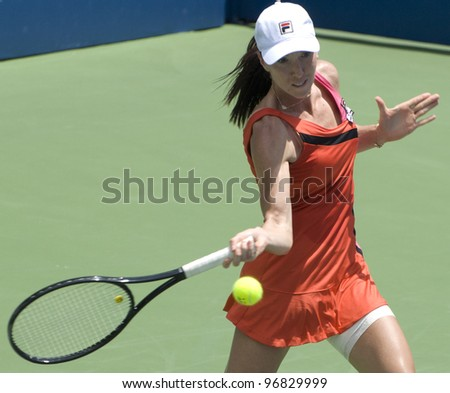 KUALA LUMPUR - MARCH 4: Jelena Jankovic (SRB) returns ball to Petra Martic(CRO) at semi final match, Martic win with 7-6, 5-7, 6-7 during BMW Malaysian Open in Kuala Lumpur, Malaysia on March 4, 2012 - stock photo