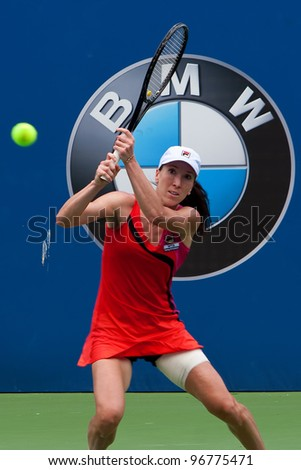 KUALA LUMPUR-MARCH 4:Jelena Jankovic(SRB) returns the ball while compete against Petra Martic(CRO) during BMW Malaysia Open on March 4, 2012 in Kuala Lumpur,Malaysia. Jankovic lost 6:7(5), 7:5, 7:6(5) - stock photo