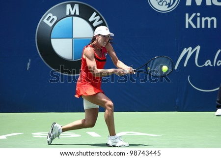 KUALA LUMPUR-MARCH 4: Jelena Jankovic(SRB) returns the ball while compete against Petra Martic(CRO) during BMW Malaysia Open on March 4, 2012 in Kuala Lumpur, Malaysia. Martic won 6:7(5),7:5,7:6(5) - stock photo