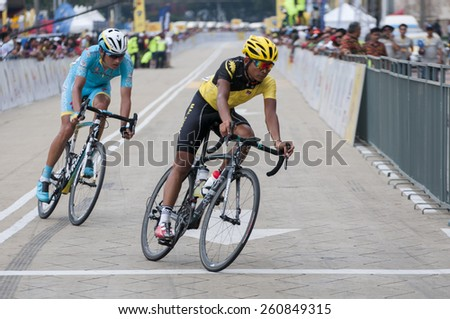 KUALA LUMPUR - MARCH 15 : Malaysian rider chasing by Astana Pro Team during stage 8 Le Tour de Langkawi 2015 from Kuala Kubu baru to Kuala Lumpur, Malaysia on March 15, 2015. - stock photo