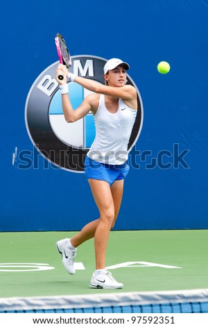 KUALA LUMPUR-MARCH 4:Petra Martic(CRO) returns the ball while compete against Jelena Jankovic(SRB) during BMW Malaysia Open on March 4, 2012 in Kuala Lumpur, Malaysia. Martic Won 6:7(5), 7:5, 7:6(5) - stock photo