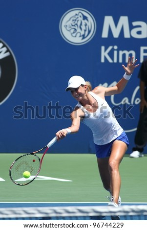 KUALA LUMPUR - MARCH 4: Petra Martic returns a ball during a semi-finals match against Jelena Jankovic at the BMW Malaysian Open on March 4, 2012 in Kuala Lumpur, Malaysia. Petra Martic won [6-7(5-7),7-5,7-6 (7-5)] - stock photo