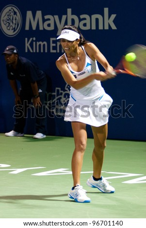 KUALA LUMPUR-MARCH 4:Su-Wei Hsieh (TPE) returns the ball while compete against Petra Martic (CRO) at BMW Malaysia Open Singles Final on March 4, 2012 in Kuala Lumpur, Malaysia. Su-Wei Won 2:6, 7:5, 4:1