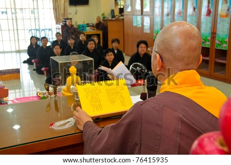 KUALA LUMPUR - MAY 1: Photo of a Buddhist master sharing his knowledge on Buddhism enlightenment to new followers during a recruitment ceremony on May 1, 2011 at a Buddhist Temple, Kuala Lumpur.