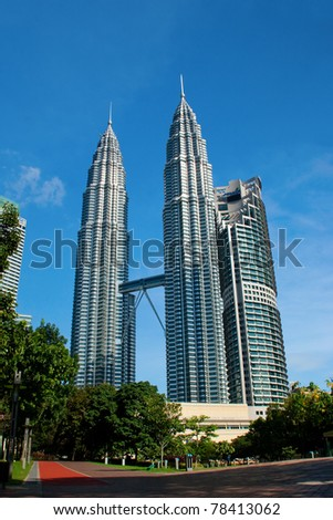 KUALA LUMPUR - MAY 28 : The Petronas Twin Towers (KLCC) with blue skies on May 28, 2011 in Kuala Lumpur, Malaysia. The skyscraper (451.9m/88 floors) remain the tallest twin buildings in the world. - stock photo