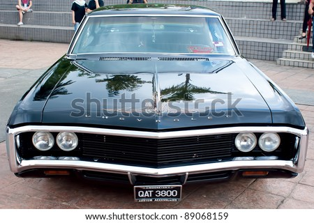 KUALA LUMPUR-NOV 13: A Chevrolet Impala on display at the Asia Klasika Malaysia International Vintage & Classic Car Concours during COTY2U Autoshow on November 13, 2011 in Kuala Lumpur, Malaysia - stock photo