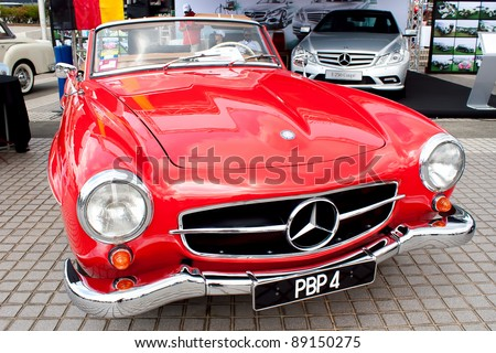 KUALA LUMPUR-NOV 13: A Mercedes-Benz 190SL on display at the Asia Klasika Malaysia International Vintage & Classic Car Concours during COTY2U Autoshow on November 13, 2011 in Kuala Lumpur, Malaysia - stock photo