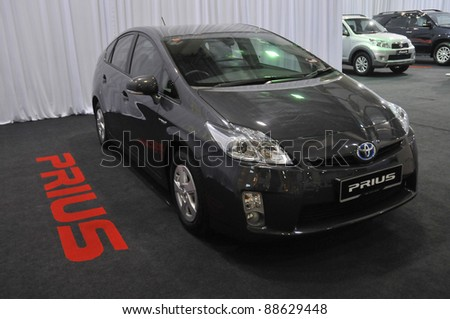 KUALA LUMPUR - NOV. 12 : A Toyota Hybrid Prius on display at Car of The Year 2U Autoshow (COTY2U 2011) on November 12, 2011 in Kuala Lumpur, Malaysia. The Prius first went on sale in Japan in 1997. - stock photo