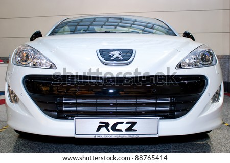 KUALA LUMPUR - NOV 13: Peugeot RCZ at the Car Of The Year Auto Show on November 13 2011 in Kuala Lumpur, Malaysia. Peugeot RCZ; a 156 hp 1.6litre engines with 6-speed automatic transmission - stock photo