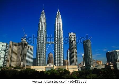 KUALA LUMPUR - NOV 16: The Petronas Twin Towers on November 16, 2010, in Kuala Lumpur, Malaysia are the world's tallest twin tower. The skyscraper height is 451.9m - stock photo