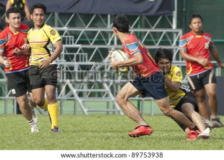 KUALA LUMPUR - NOV, 27: Unidentified players in action during Jonah Jones 7's 2011, organized by Royal Selangor Club (RSC) on Sunday, November 27, 2011 in Kuala Lumpur, Malaysia. - stock photo