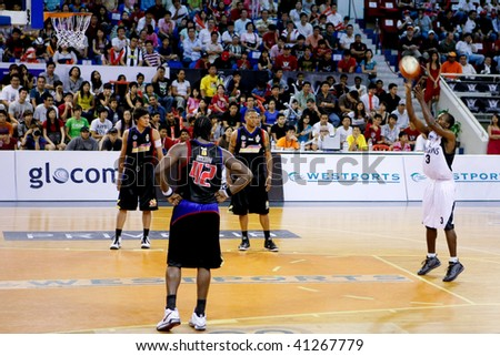 KUALA LUMPUR - NOVEMBER 15: KL Dragons Chris Kuete takes a free throw against the Philippine Patriots in the ASEAN Basketball League match. November 15, 2009 in Kuala Lumpur. - stock photo