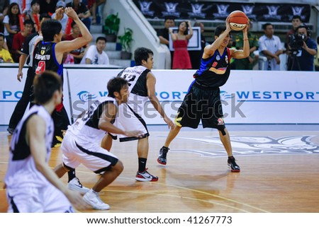 KUALA LUMPUR - NOVEMBER 15: KL Dragons take on Philippine Patriots in the ASEAN Basketball League match. November 15, 2009 in Kuala Lumpur. - stock photo