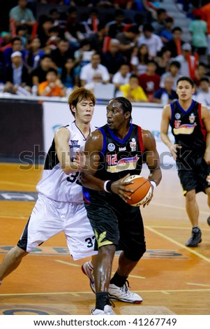 KUALA LUMPUR - NOVEMBER 15: Philippine Patriots' Jason Dixon in action in the ASEAN Basketball League match. November 15, 2009 in Kuala Lumpur. - stock photo