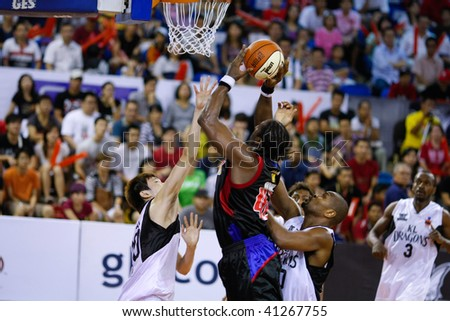 KUALA LUMPUR - NOVEMBER 15: Philippine Patriots' Jason Dixon shoots against the KL Dragons in the ASEAN Basketball League match. November 15, 2009 in Kuala Lumpur. - stock photo