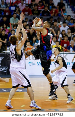 KUALA LUMPUR - NOVEMBER 15: Philippine Patriots' Robert Wainwright outjumps everyone in the ASEAN Basketball League match. November 15, 2009 in Kuala Lumpur. - stock photo