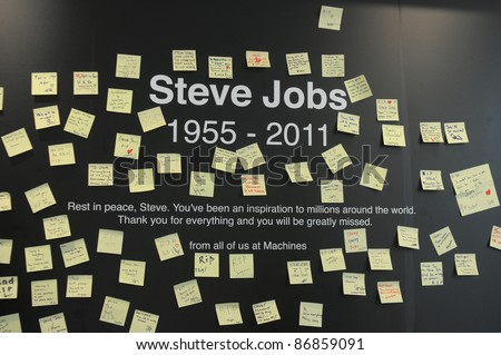 KUALA LUMPUR - OCTOBER 6: A memorial of posted notes for Steve Jobs  is created at Apple Store on October 6, 2011 in Kuala Lumpur, Malaysia. - stock photo
