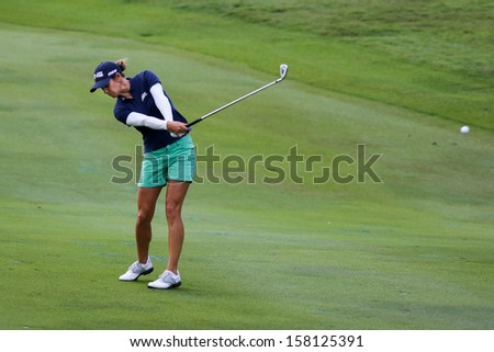 KUALA LUMPUR - OCTOBER 13: Azahara Munoz of Spain hits the ball to the 2nd hole green of the KLGCC course on the final day of the Sime Darby LPGA on October 13, 2013 in Kuala Lumpur, Malaysia.