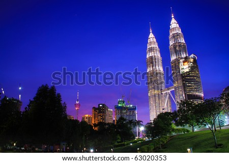 KUALA LUMPUR - OCTOBER 14: Beautiful night lighting of Petronas Twin Towers (KLCC) October 14, 2010 in Kuala Lumpur, Malaysia.  The Petronas Twin Towers remain the tallest twin buildings in the world.