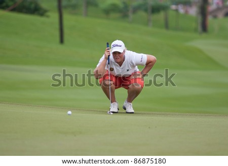 KUALA LUMPUR - OCTOBER 16: Caroline Hedwall of Sweden lines up for a putt on the final day of the Sime Darby LPGA Malaysia 2011 on October 16, 2011 at the Kuala Lumpur Golf & Country Club, Malaysia. - stock photo
