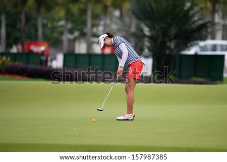 KUALA LUMPUR - OCTOBER 12: Chella Choi of South Korea putts on the 2nd hole green of the KLGCC course on Day 3 of the Sime Darby LPGA on October 12, 2013 in Kuala Lumpur, Malaysia.