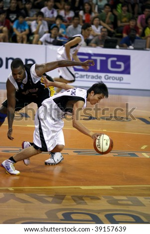 KUALA LUMPUR - OCTOBER 13: KL Dragons take on Brunei Barracudas in the ASEAN Basketball League match. October 13, 2009 in Kuala Lumpur. - stock photo
