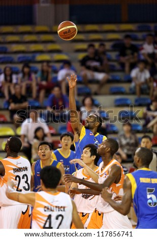 KUALA LUMPUR - OCTOBER 27: Stallions player (blue) and Firehorse players (white) scramble for a loose ball in a Malaysia National Basketball League match on October 27, 2012 in Kuala Lumpur, Malaysia. - stock photo