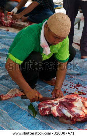 KUALA LUMPUR-SEP 24: An unidentified Malaysian prepares meat to distribute to the poor and homeless during Eid Al-Adha Al Mubarak,the Feast of Sacrifice September 24, 2015 in Kuala Lumpur, Malaysia - stock photo