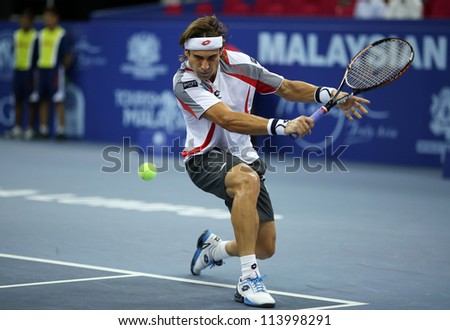KUALA LUMPUR - SEP 27: David Ferrer of Spain plays his round 2 match at the ATP Tour Malaysian Open 2012 on September 27, 2012 at the Putra Stadium, Kuala Lumpur, Malaysia. He beat Alex Bogomolov Jr. - stock photo