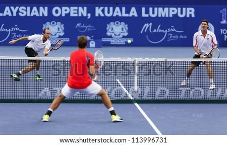 KUALA LUMPUR - SEP 25: James Cerretani (white/left) partners Matthew Ebden in the doubles event at the ATP Tour Malaysian Open 2012 on September 25, 2012 at the Putra Stadium, Kuala Lumpur, Malaysia. - stock photo