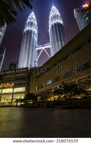 KUALA LUMPUR - SEP 18: PETRONAS Twin Towers on SEP 18, 2015 in Kuala Lumpur, Malaysia. It was the tallest building in the world from 1998 to 2004 and remains the tallest twin tower in the world.